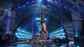 hand balancer performs with two puppies (america's got talent 2014 - semifinals) - christian stoinev - v.a
